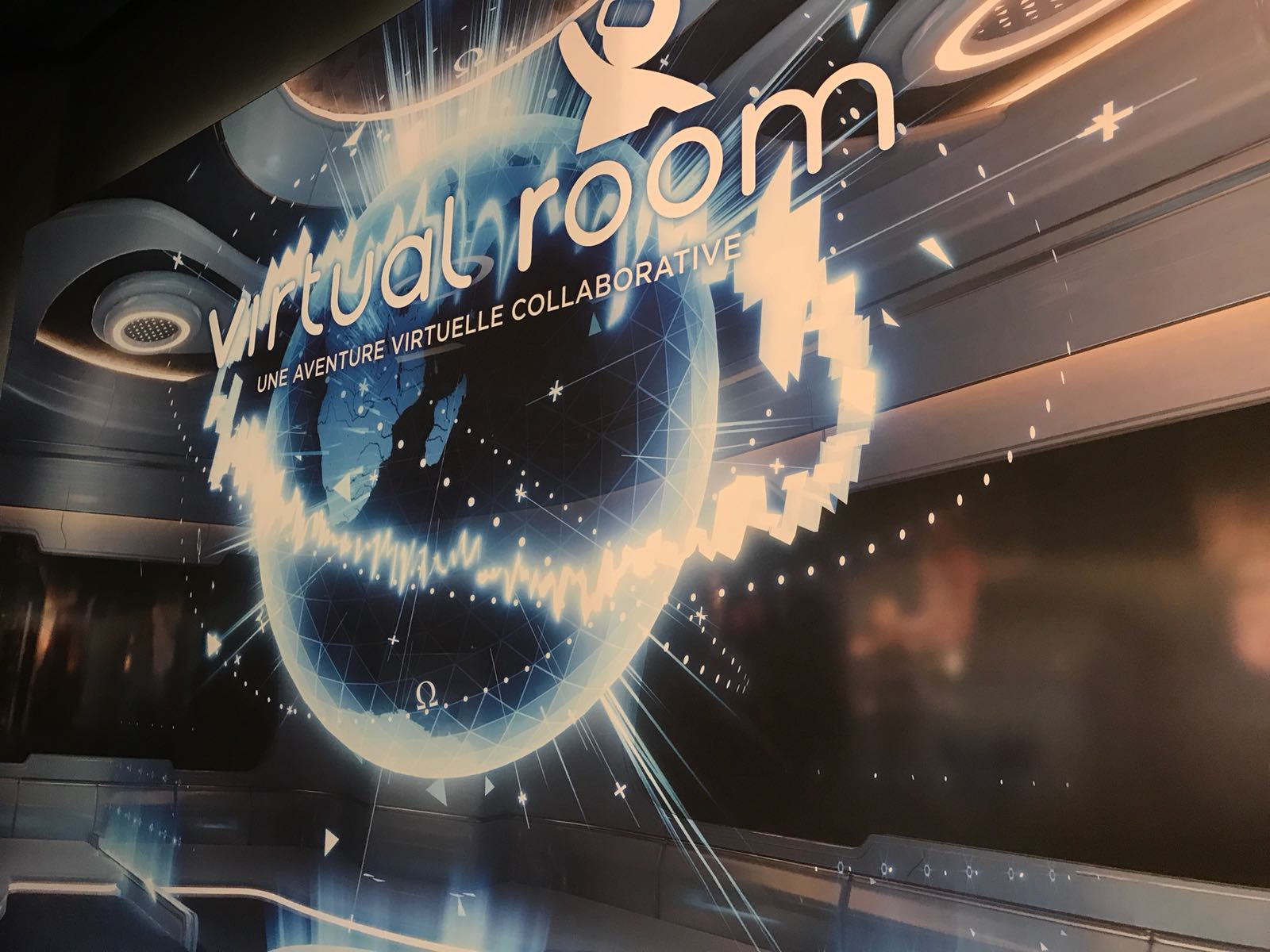 The Virtual Room logo on the wall