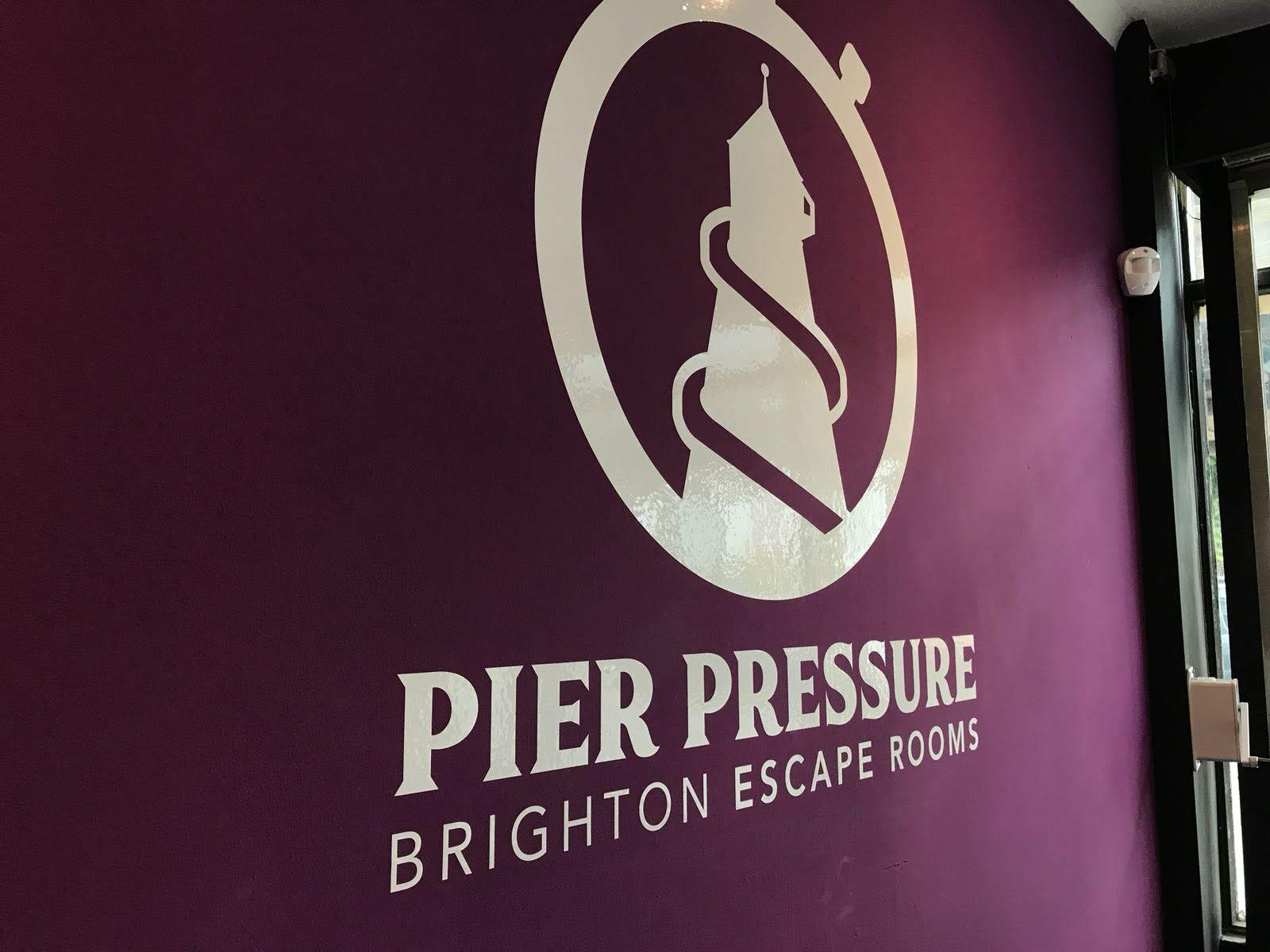 Pier Pressure logo on the wall in their lobby