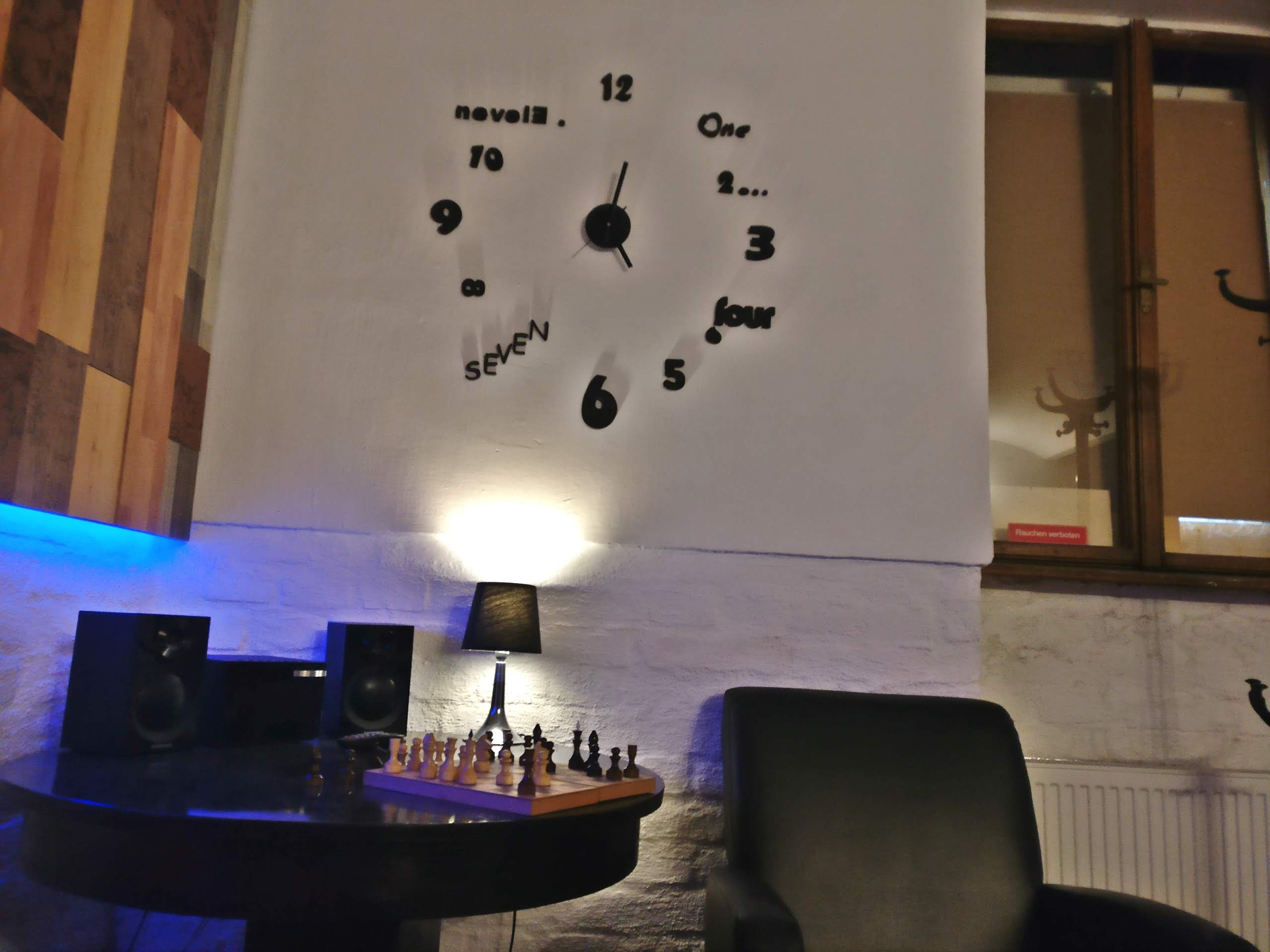 A clock and chess board inside the lobby area