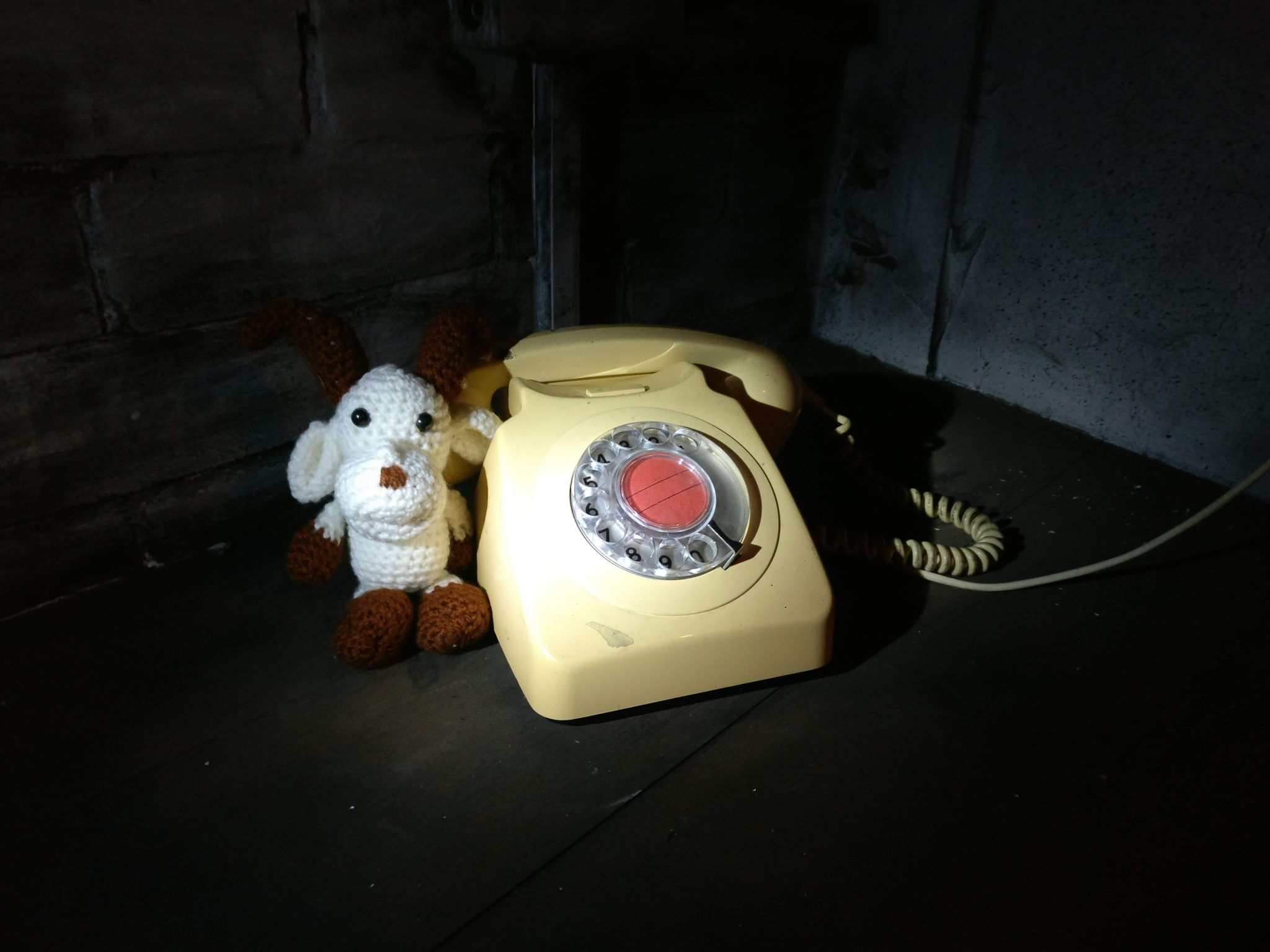 Gary the goat by the telephone inside the escape room